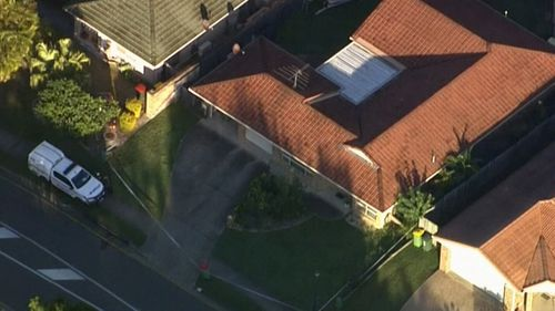 The girl was found dead in a Redland Bay home.