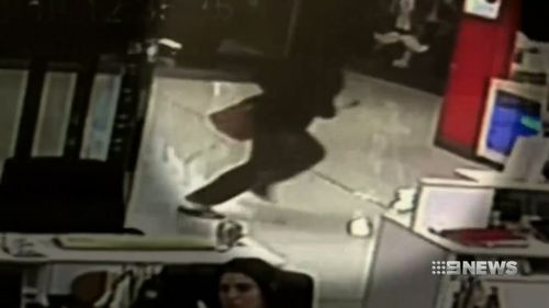 Wearing a balaclava and brandishing a shotgun, the thief rushed into Arndale Shopping Centre. (9NEWS)
