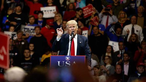 "President-elect Donald Trump gestures as he speaks during a ""USA Thank You"" tour event. (AAP)"