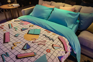 Blockbuster Airbnb fold-out couch with '90s bedding