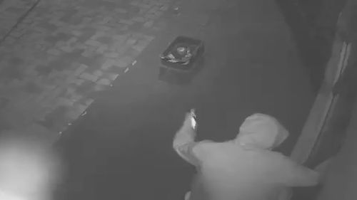 CCTV of a hooded man at a Prospect Road business in Adelaide.