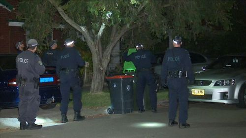 The masked men ransacked the house after tying up the family. (9NEWS)