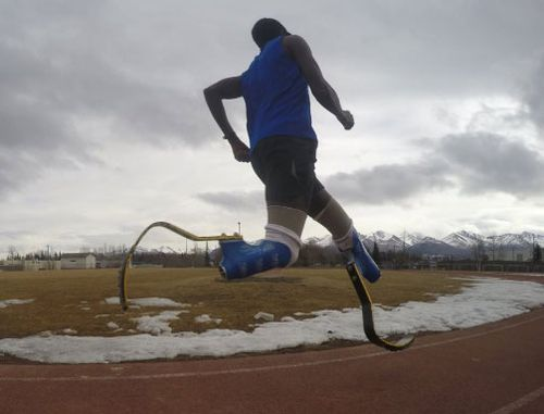 Amputee runner Marko Cheseto training on a track in Alaska.