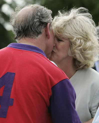 Prince Charles wins a prize and a kiss from his wife Camilla the Duchess of Cornwall after polo at Cirencester on June 17, 2005 in Cirencester, England.