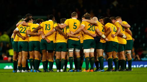 The Wallabies in a huddle after their crucial win. (Getty)