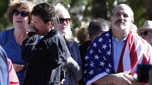 Mourners and residents lined the streets for the procession in a show of respect for the sergeant who lost his life trying to protect the college students at the California bar.
