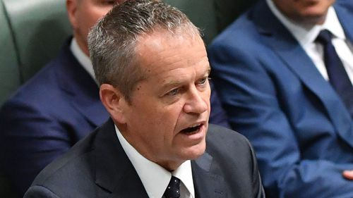 "Labor leader Bill Shorten said the government had made Mr Milne's position ""untenable""."