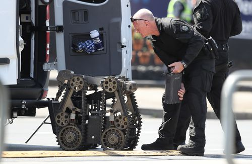 Bomb squad sweep area following arrest of man with 'unknown device'