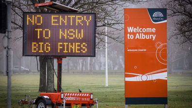 A sign warning Victorians not to enter NSW in Albury, on the border.