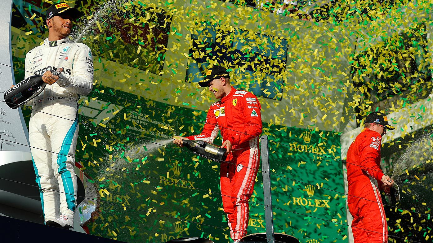 German driver Sebastian Vettel of Ferrari(centre) celebrates winning the Formula 1 2018 Australian Grand Prix