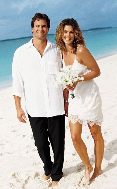 <p>Cindy Crawford and Rande Gerber, 1998</p> <p>The bride wore - John Galliano</p>