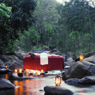 Scenic Rim woman gets outdoor massage in a creek