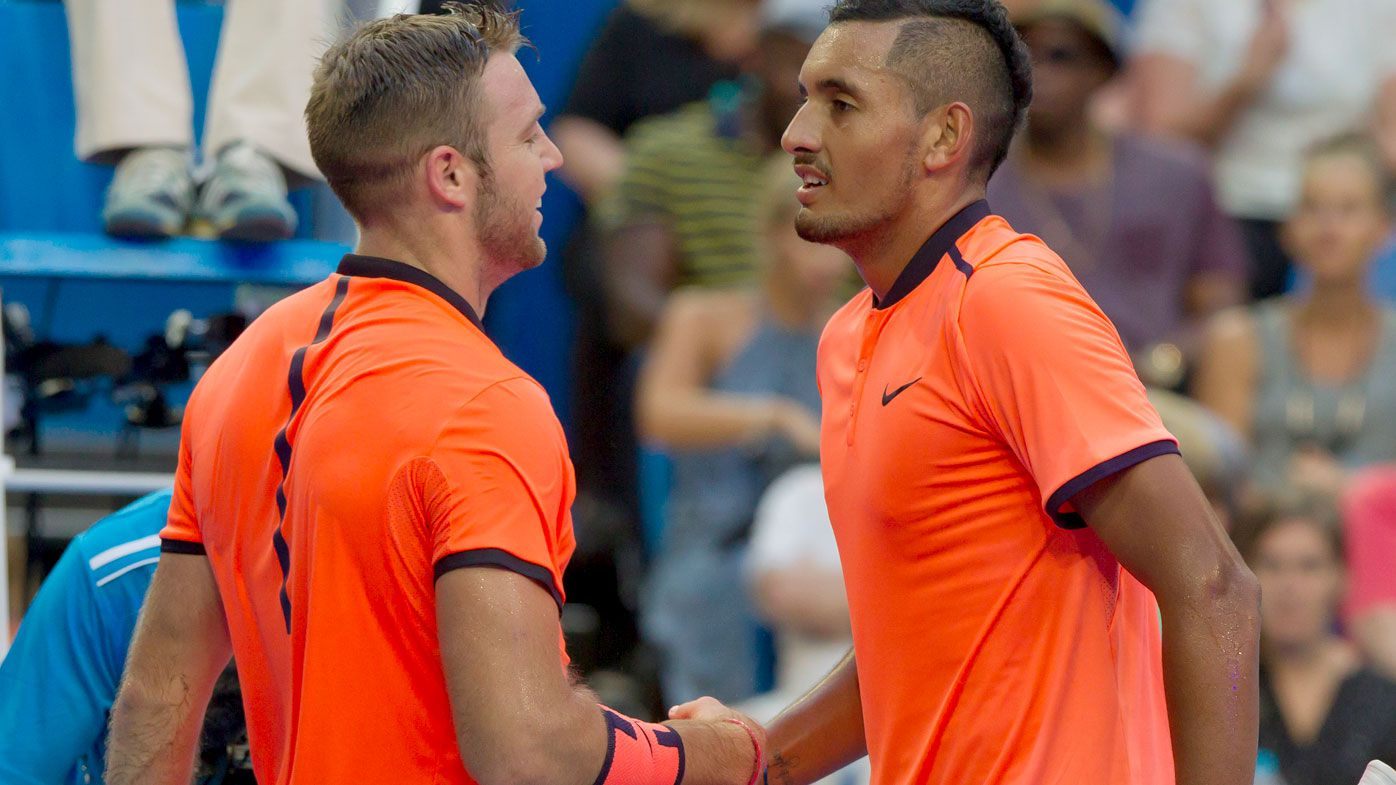 Nick Kyrgios (right) congratulates Jack Sock on his victory at the Hopman Cup in Perth. (AFP)