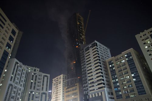Civil defence forces extinguish a fire that broke out at a high-rise building in Sharjah