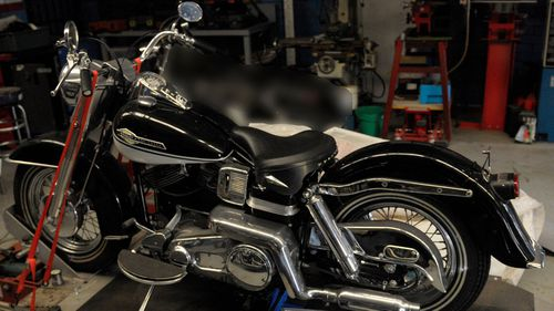 One of the three black Harley Davidson motorcycles.