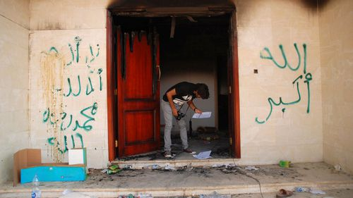 A man looks at documents at the U.S. Consulate in Benghazi, Libya, the day after an attack that killed four Americans, including Ambassador Chris Stevens. (AP)