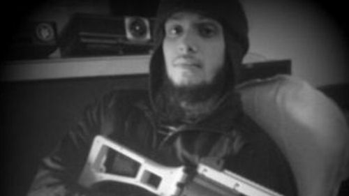 British man Nahin Ahmed holding a toy gun - pre travel to Syria - in an image that was taken from his computer by UK police. Credit: West Midlands Police