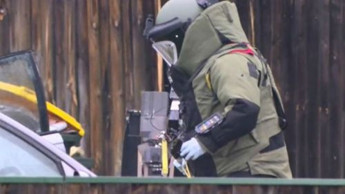 Heavily clad bomb squad investigators were at the scene. (9NEWS)