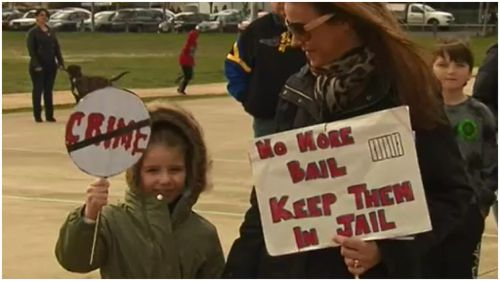 Children and their parents protested for larger numbers of police. (9NEWS)