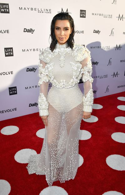 """With her fresh haircut worn in a wet style, <a href=""""https://style.nine.com.au/2016/09/07/09/43/kim-kardashian-kanye-see-through-boots"""" target=""""_blank"""">Kim Kardashian</a> turned the Los Angeles Fashion Awards into yet another trip down the aisle by wearing a <a href=""""http://style.nine.com.au/2017/03/17/14/26/style-givenchy-new-director"""" target=""""_blank"""">Givenchy</a> gown inspired by the dress she wore to marry Kanye West in 2014.<br> """"I think seeing this pic is a sign,"""" Kim<a href=""""https://twitter.com/KimKardashian/status/848654032935583744"""" target=""""_blank""""> tweeted</a> with a bridal selfie before the event. """"Maybe I will wear @givenchy tonight.""""<br> For the third awards hosted by <em>The Daily Front Row</em> Kardashian was joined as a presenter by Lily Aldridge, Hailey Baldwin, Fergie and Busy Philips.<br> Gongs went out to <a href=""""http://style.nine.com.au/2017/03/03/10/05/paris-jackson-model-img"""" target=""""_blank"""">Paris Jackson</a> for Emerging Talent, Kristen Stewart's gal pal Stella Maxwell for Model of the Year, DVF's Jonathan Saunders for Designer of the Year, Karla Welch for Women's Stylist of the Year, Samantha McMillen for Men's Stylist of the Year, Stephen Gan for the Visionary Award, Nicki Minaj for Fashion Rebel, Kaia's big brother Presley Gerber for Emerging Model, and Yolanda Hadid for Mother of the Year. <br> <br>"""