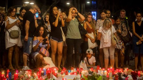 Dozens of mourners have converged at a memorial on Las Ramblas Avenue. (AP)