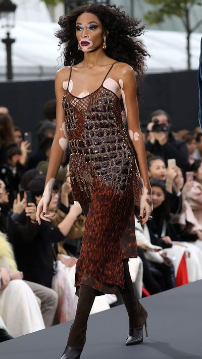 Canadian model Winnie Harlow worked the catwalk like a pro in thigh-high boots and a strappy gown.