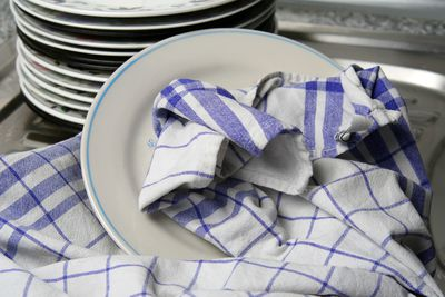 7. Using a tea towel to wipe a spill