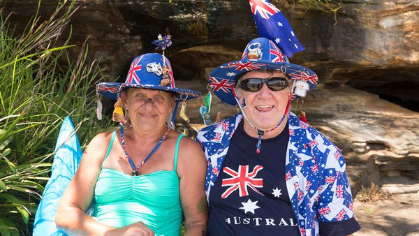 That's the spirit - an Aussie couple showing the world how it's done. Image: Getty.