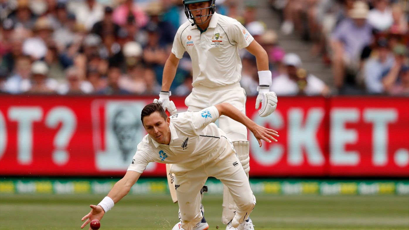 Boult dives for a ball off the MCG wicket