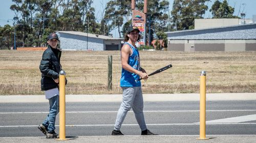 Two thugs seen walking around Wyndham Vale station with weapons.