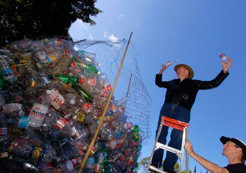 In 2005 Clean Up Australia chairman Ian Kiernan deposits plastic drink bottles in a huge waste basket set up in Sydney's Hyde Park after announcing a refund scheme to encourage people to recycle their plastic bottles.