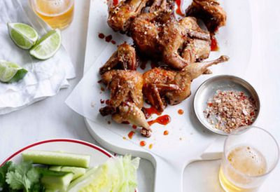 Fried quail with cucumber and lettuce wedges