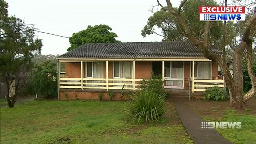 A man armed with a spanner forced entry to her Wollongong home.