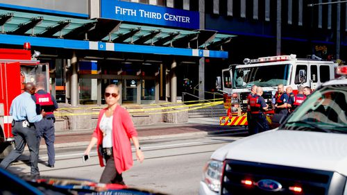 Witnesses said more than a dozen gun shots were heard being fired off inside the building.