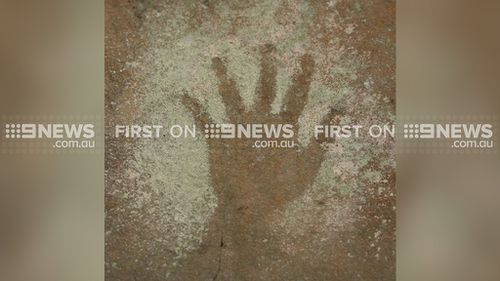 ANCIENT HANDPRINT: Treasure trove of Aboriginal art found in Sydney suburb