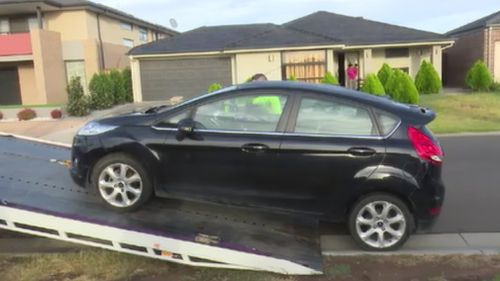Cars were among the items seized. (Supplied)