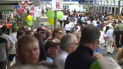 Businesses around the small northern NSW town were closed today as hundreds packed the sports hall. (9NEWS)