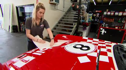 Sign writer Chrissy Gensch said the variety of her job was exciting.