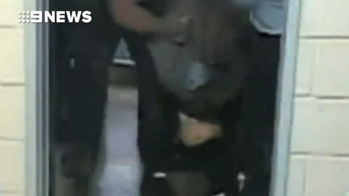 Confronting video showed guards leaning on Morrison as they restrained him.