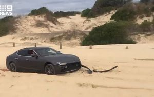Maserati's bumper ripped clean off in recovery effort after becoming stuck in Port Stephens sand dunes