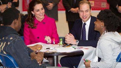 The Duke and Duchess of Cambridge talk with students Nya Hayer, right, and Steffon Bell as they visit The Door, a service for disadvantaged young people. (AAP)