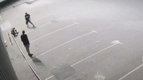 The cleaner was on a break, sitting in a carpark outside his work when two men approached him and beat him with a rock.