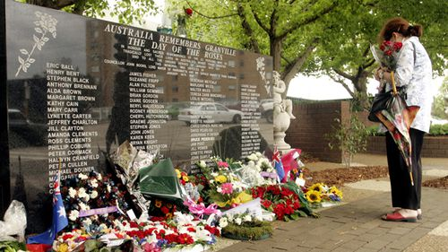 Wreaths laid after a memorial service on the 28th anniversary of the Granville Train disaster in 2004. Source: AAP
