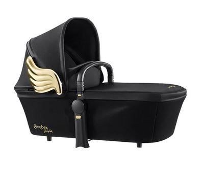 "<a href=""http://shop.davidjones.com.au/djs/ProductDisplay?catalogId=10051&amp;productId=11061016&amp;langId=-1&amp;storeId=10051&amp;cm_mmc=googlesem-_-PLA-_-Baby+and+Toddler+-+Baby+Safety-_-Cybex+Cybex+Priam+Carry+Cot+-Jeremy+Scott+Wings&amp;CAWELAID=620017140003531881&amp;CAGPSPN=pla&amp;CAAGID=18484467736&amp;CATCI=pla-51320962143&amp;gclid=CNaW65ak3NECFYkIvAodpqYJpA&amp;gclsrc=aw.ds"" target=""_blank"">Cybex Priam Carry Cot, $799.99.</a>"