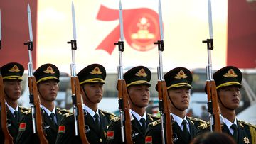 Members of a Chinese military honour guard stand at attention during a rehearsal before a large parade to commemorate the 70th anniversary of the founding of Communist China in Beijing