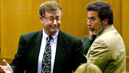 Michael Peterson reacts in 2003 after being found guilty of murdering his wife in Durham, N.C. At right is his attorney David Rudolf. (AAP)