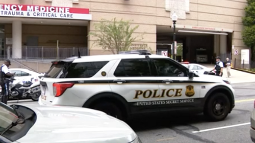Police patrol outside a D.C -area hospital after the shooting near the Pentagon.