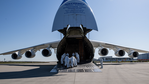Workers unload a shipment of 10 million protective face masks and other protective medical gear that had arrived on an Antonov 225 cargo plane from China at Leipzig/Halle Airport during the novel coronavirus crisis on April 27, 2020 in Schkeuditz, Germany.