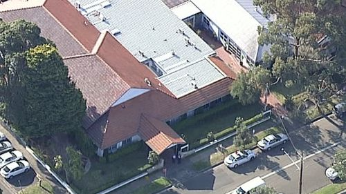 Police and emergency services at Longueville Hospital. (9NEWS)