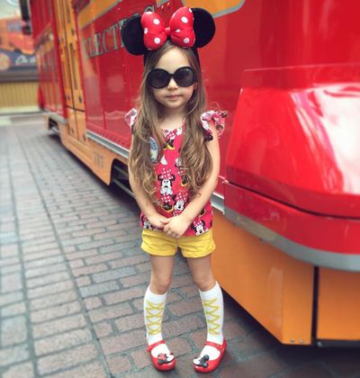<strong>6. Atalie</strong> is a sweet little child model with a penchant for Disney themes and oversized shades.